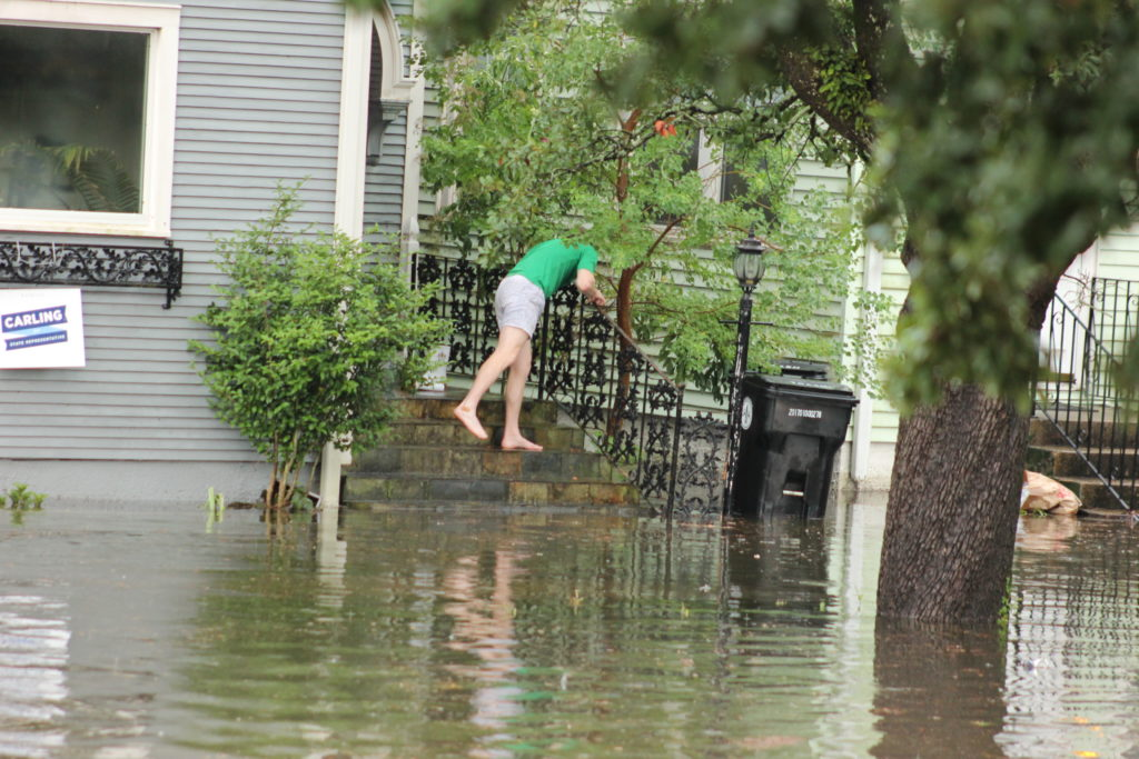 Neighbors observing rising water levels.