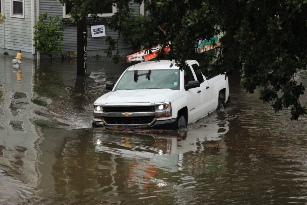 Vehicles struggle to escape flash-flooded neighborhood streets during Tropical Storm Barry (July 2019).