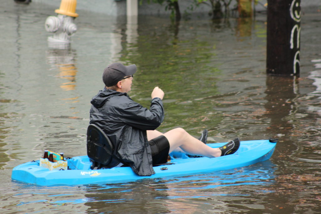 Canoeing down the street with a 12-pack on-hand.