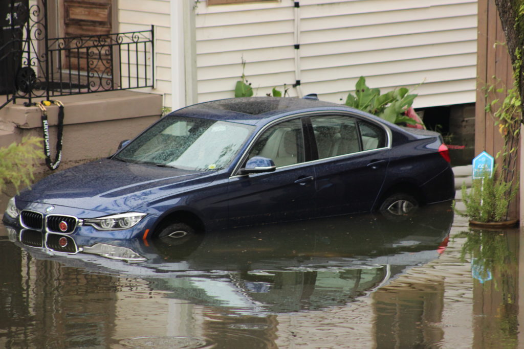 Cars underwater in driveways.